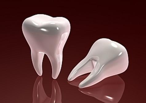 сниться випадання зубів